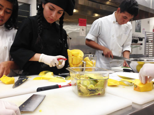 Picture of students preparing a dish