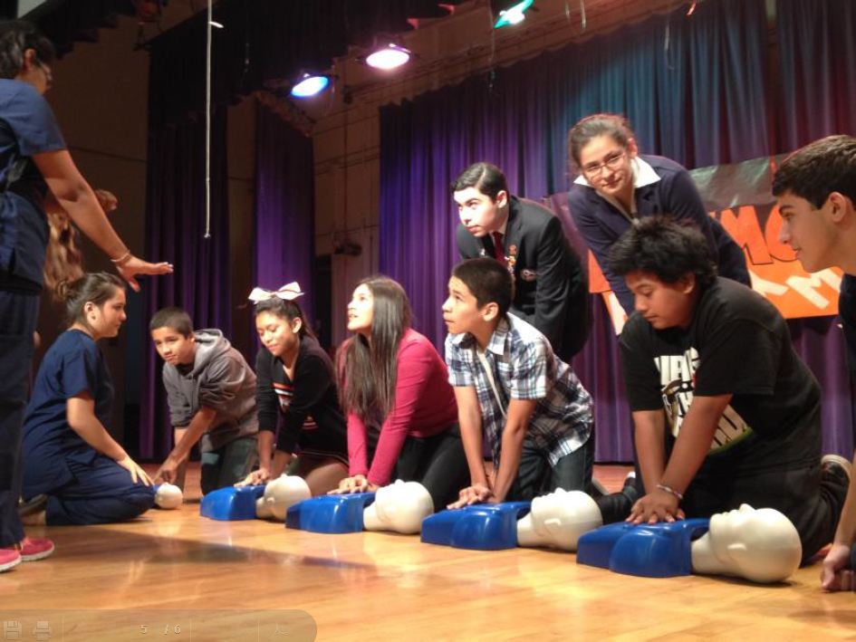 Picture of ATC Health students demonstrating CPR to 8th graders